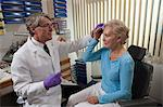Ophthalmologist applying ice on a patient's forehead after a Botox treatment Stock Photo - Premium Royalty-Free, Artist: ableimages, Code: 6105-05396652