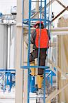 Engineer climbing a tower with safety enclosure Stock Photo - Premium Royalty-Free, Artist: AWL Images, Code: 6105-05396943