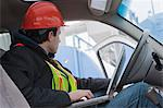 Engineer using a laptop in truck at fueling site Stock Photo - Premium Royalty-Free, Artist: Transtock, Code: 6105-05396967