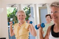 Women exercising with dumbbells in a health club Stock Photo - Premium Royalty-Freenull, Code: 6105-05397074