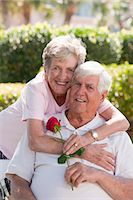 Portrait of a woman hugging a man from behind Stock Photo - Premium Royalty-Freenull, Code: 6105-05397121