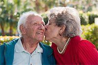 Senior couple romancing in a park Stock Photo - Premium Royalty-Freenull, Code: 6105-05397127