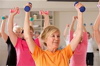 fitness older women gym - Seniors exercising with dumbbells in a health club Stock Photo - Premium Royalty-Freenull, Code: 6105-05397160