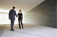 Businesspeople shaking hands in empty office Stock Photo - Premium Royalty-Freenull, Code: 614-05399601