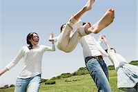 Parents lifting son mid air Stock Photo - Premium Royalty-Freenull, Code: 614-05399833