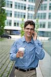 Man talking on cell phone in city Stock Photo - Premium Royalty-Free, Artist: Universal Images Group, Code: 632-05400945