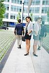 Businesswoman talking on cell phone outside of office building Stock Photo - Premium Royalty-Free, Artist: Cusp and Flirt, Code: 632-05400972