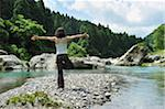 Woman doing yoga in the river Stock Photo - Premium Royalty-Freenull, Code: 6106-05404949