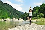 Woman doing yoga in the river Stock Photo - Premium Royalty-Freenull, Code: 6106-05404952