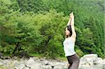 Woman doing yoga in the river Stock Photo - Premium Royalty-Freenull, Code: 6106-05404961