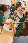 Four pre-school girls playing in classroom Stock Photo - Premium Royalty-Free, Artist: Robert Harding Images    , Code: 6106-05406470