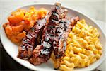 BBQ Ribs with Sweet Potatoes and Mac 'n' Cheese Stock Photo - Premium Royalty-Free, Artist: Photocuisine, Code: 6106-05407212