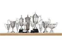 11n Silver trophies on maple shelf Stock Photo - Premium Royalty-Freenull, Code: 6106-05408626