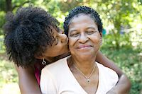 Daughter kissing mother Stock Photo - Premium Royalty-Freenull, Code: 6106-05408691