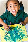 Preschool girl hand painting in class Stock Photo - Premium Royalty-Free, Artist: Rick Gomez, Code: 6106-05408864