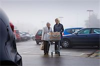 person walking on parking lot - senior supermarket shopper with female volunteer Stock Photo - Premium Royalty-Freenull, Code: 6106-05409790