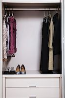 view of a tidy female wardrobe Stock Photo - Premium Royalty-Freenull, Code: 6106-05410372