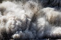 exploding - Blast of dirt and rocks Stock Photo - Premium Royalty-Freenull, Code: 6106-05411629