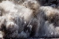 exploding - Blast of dirt and rocks Stock Photo - Premium Royalty-Freenull, Code: 6106-05411632