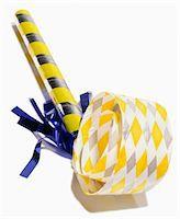 Party noise maker or horn blower on white Stock Photo - Premium Royalty-Freenull, Code: 6106-05412377