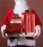 Santa holding stack of Christmas presesnts