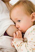 Woman's breast feeding her daughter. Stock Photo - Premium Royalty-Freenull, Code: 6106-05413120