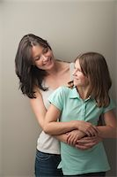preteen long hair - Portrait of mother and daughter Stock Photo - Premium Royalty-Freenull, Code: 6106-05416849