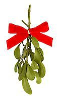 Mistletoe with Red Bow Ribbon on White Stock Photo - Premium Royalty-Freenull, Code: 6106-05417025