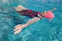 seniors and swim cap - Woman Floating Stock Photo - Premium Royalty-Freenull, Code: 6106-05418472
