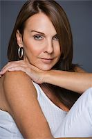 Beauty portrait of woman in white Stock Photo - Premium Royalty-Freenull, Code: 6106-05418813