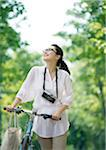 Young woman taking a walk with bicycle Stock Photo - Premium Royalty-Free, Artist: Robert Harding Images, Code: 6106-05418949