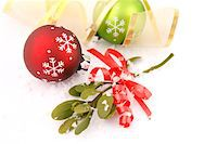 Christmas Baubles and Mistletoe in Snow Stock Photo - Premium Royalty-Freenull, Code: 6106-05421512
