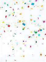 Multicolored Confetti on White Background Stock Photo - Premium Royalty-Freenull, Code: 6106-05421997