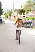 Woman riding bicycle Stock Photo - Premium Royalty-Freenull, Code: 6106-05425952