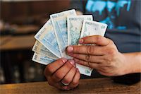 people in argentina - Man holding Argentinian pesos Stock Photo - Premium Royalty-Freenull, Code: 6106-05428801