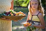 Portrait of young girl with freshly picked fruit