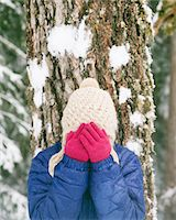A Woman hiding her face in her hands in the snow Stock Photo - Premium Royalty-Freenull, Code: 6106-05431904