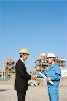 Men who work by industrial installation Stock Photo - Premium Royalty-Freenull, Code: 6106-05436365