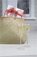 Glasses of Champagne and present Stock Photo - Premium Royalty-Freenull, Code: 6106-05439413