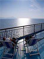 Couple aboard cruise ship Stock Photo - Premium Royalty-Freenull, Code: 6106-05440638