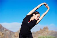 stretching (people exercising) - Caucasian female stretching in volcanic area Stock Photo - Premium Royalty-Freenull, Code: 6106-05442289