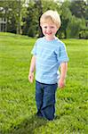 Little boy playing outside in the yard Stock Photo - Premium Royalty-Free, Artist: Minden Pictures, Code: 6106-05442475