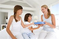 Daughter giving a present to her mother Stock Photo - Premium Royalty-Freenull, Code: 6106-05443786