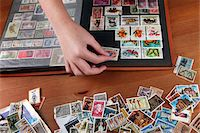 stamped - Collecting stamps Stock Photo - Premium Royalty-Freenull, Code: 6106-05445543