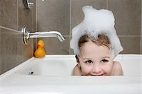 Girl taking bubble bath. Stock Photo - Premium Royalty-Freenull, Code: 6106-05446268