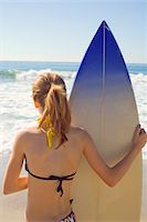 Preteen with Surfboard at Beach Stock Photo - Premium Royalty-Freenull, Code: 6106-05447092