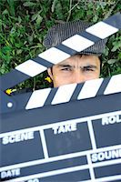 slate - Man behind a clapperboard Stock Photo - Premium Royalty-Freenull, Code: 6106-05447739