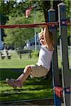 little girl playing on Jungle gym Stock Photo - Premium Royalty-Freenull, Code: 621-05450259