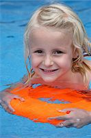 Girl Swimming with Orange Float in Swimming Pool Stock Photo - Premium Rights-Managed, Artist: Steve McDonough, Code: 700-05450959