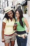 Two Friends with Cell Phone Stock Photo - Premium Rights-Managed, Artist: Peter Griffith, Code: 700-05451002